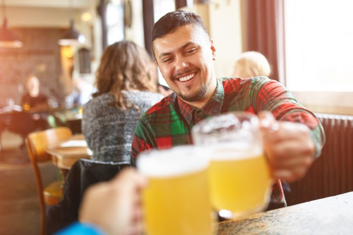 guy smiling with beer